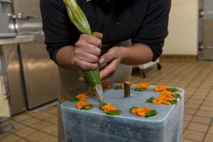 Steamed, mashed yams are piped onto an ice layer for a decorative touch.