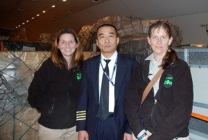 Dr. Beth (at right) and Jennifer pose with their flight captain.