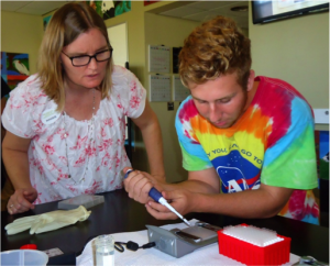 Mrs. Reinbold demonstrates how we would insert our DNA samples into the e-gel pad. It was important that we accurately measure out the DNA so that the chromosomes would be in proportion and be able to find their way to the positively charged end of the pad. If the chromosomes took longer to reach the end, that meant the chromosomes were bigger, and vice versa. The size in chromosomes helped to determine the gender of our condor.