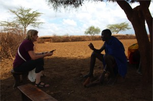 Christine Brown-Nunez, PhD a human dimensions of conservation specialist talking about wildlife interactions with a maasai warrior just outside Amboseli National Park.