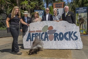 Ruva, a South African porcupine breaks ground on the largest expansion in the Zoo's 99-year history. Pictured from left to right: Krista Perry, animal trainer, San Diego Zoo; Conrad Prebys, who gave the visionaly gift of 11 million for Conrad Prebys Africa Rocks; and Debbie Turner. At center: principal donor Ernest Rady and wife Evelyn Rady. At far right: Robert Horsman, chairman of the board, San Diego Zoo Global.